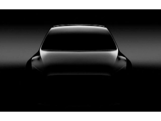 Elon Musk loveste din nou: prima imagine teaser cu Tesla Model Y