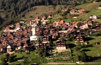 Un sat din Elvetia ofera 70.000 de mii de franci familiilor cu doi copii care merg sa locuiasca acolo