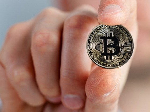 Bitcoin se indreapta spre pragul de 10.000 de dolari
