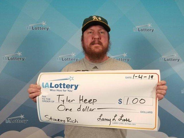 Un barbat a cerut loteriei sa ii scrie un cec urias pentru doar un dolar castigat