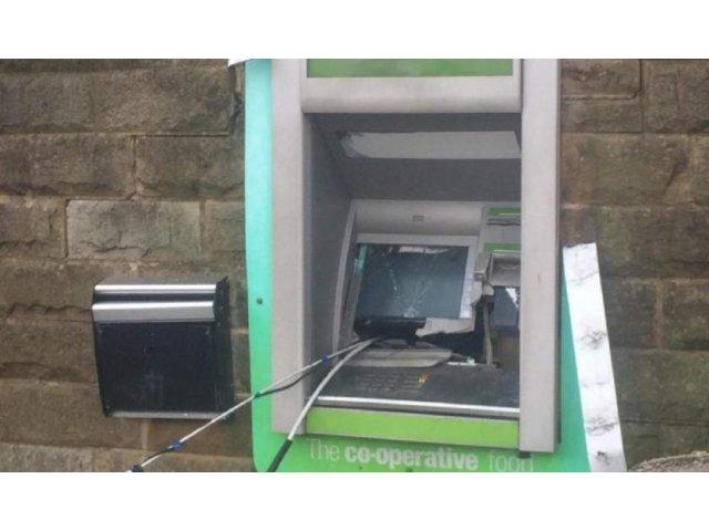 Doi romani, arestati dupa ce au aruncat in aer un bancomat la Londra