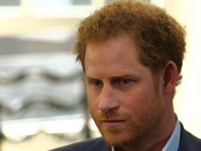 Printul Harry a primit despagubiri substantiale din partea unei agentii de presa pentru fotografii cu locuinta sa