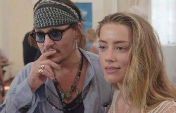Johnny Depp o acuza pe Amber Heard ca s-a prezentat in instanta cu