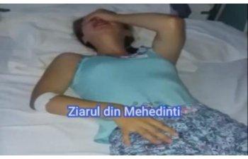O asistenta tipa la o pacienta care plange de dureri: