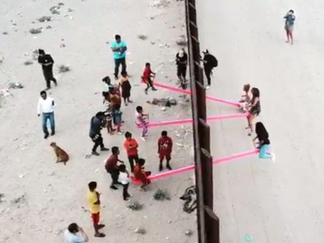 La granita Mexic-SUA s-au montat balansoare, iar copiii situati de-o parte si de alta se joaca impreuna